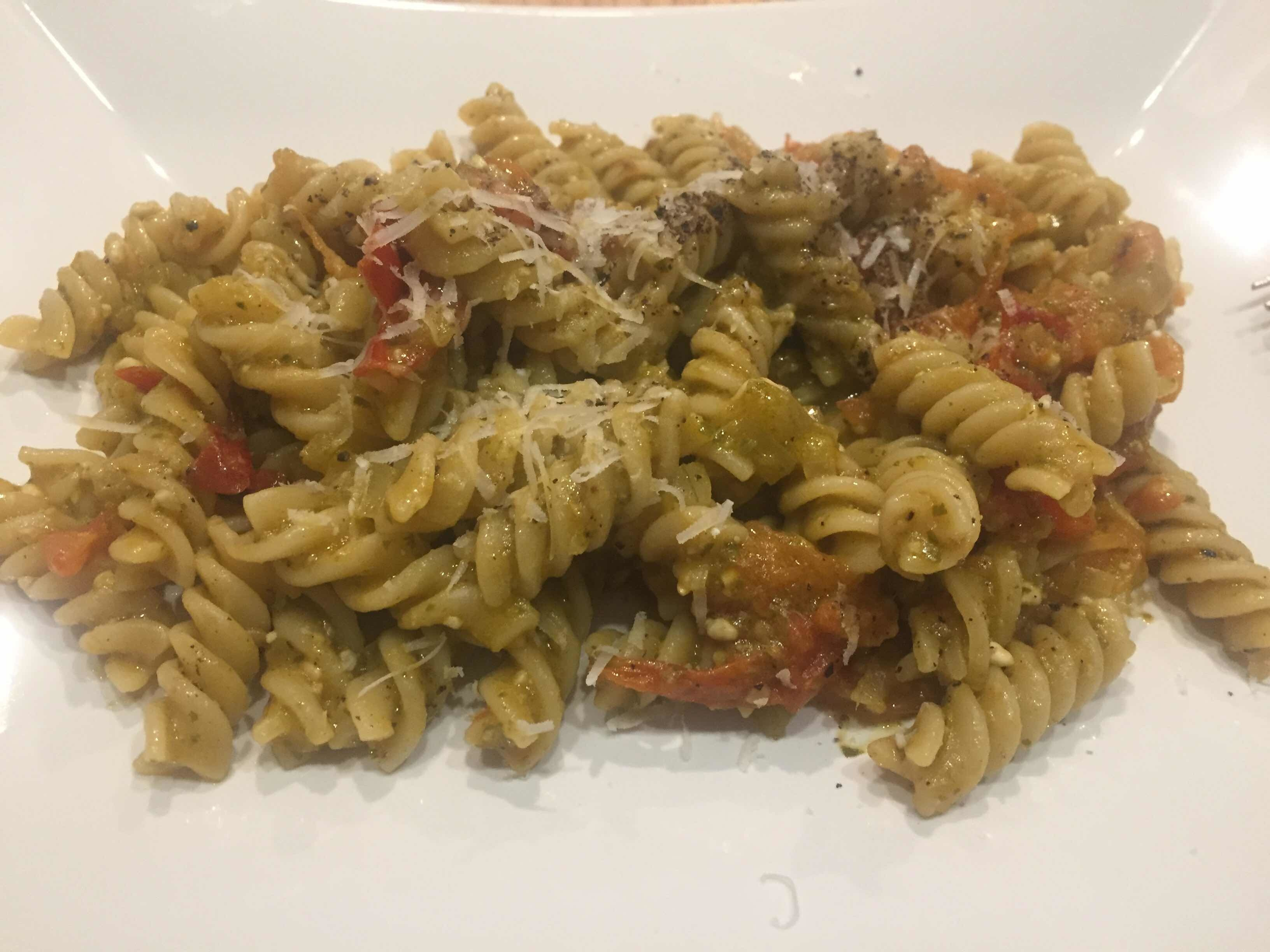 Pasta with pesto and cherry tomatoes