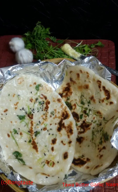 Tawa  Butter Garlic Naan (Garlic Flavored  Indian  Flat Bread Cooked On Gas Stove)