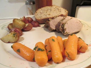 Herb Crusted Pork Tenderloin w/ Roasted Red Potatoes, Glazed Mini Carrots, and…