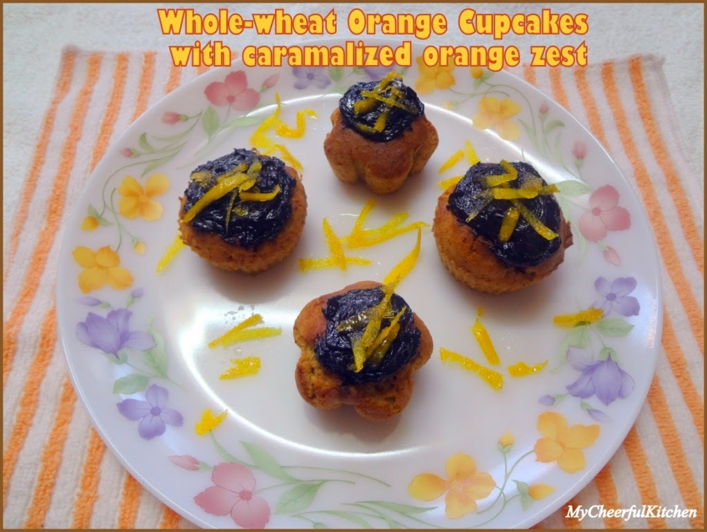 Whole-wheat orange jaggery cupcakes with caramelized orange zest (Eggless and butterless)