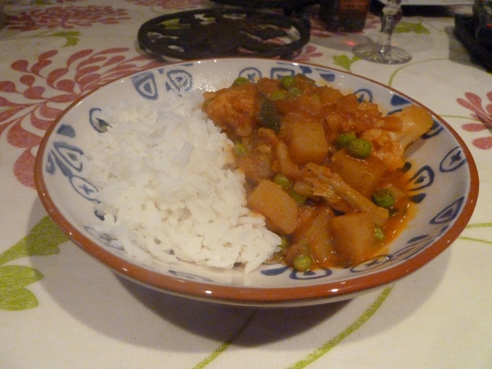 Potato, cauliflower and courgette curry with rice