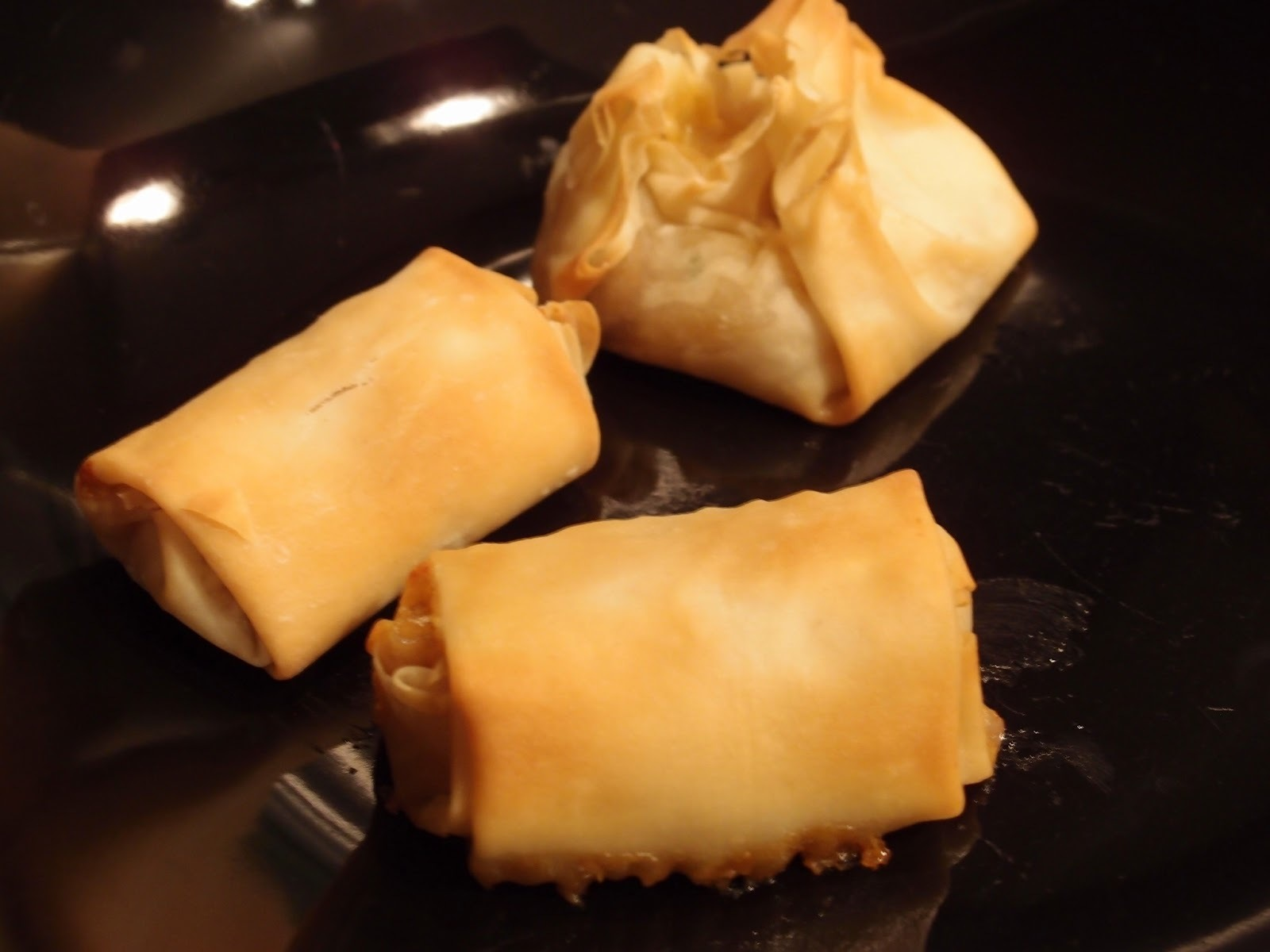 A trio of vegetarian filo parcels