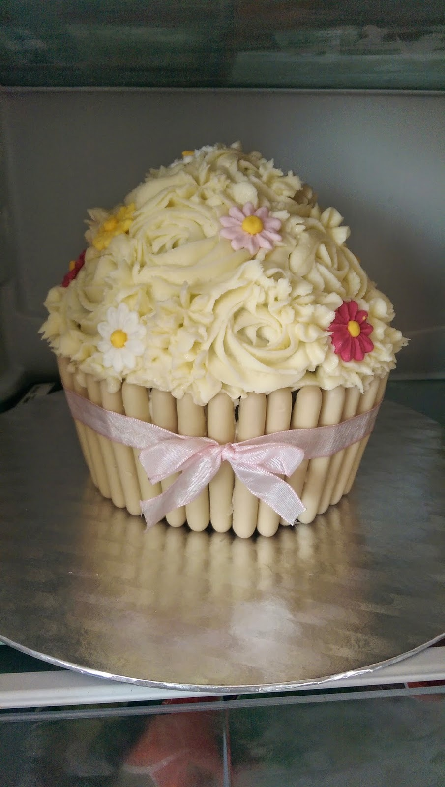 giant cupcake with chocolate fingers