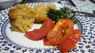 Root vegetable cake, kale with blue cheese dressing, roast tomatoes