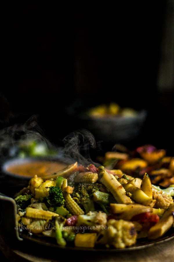 Paneer Tikka Sizzler with Makhni Sauce and assorted vegetables