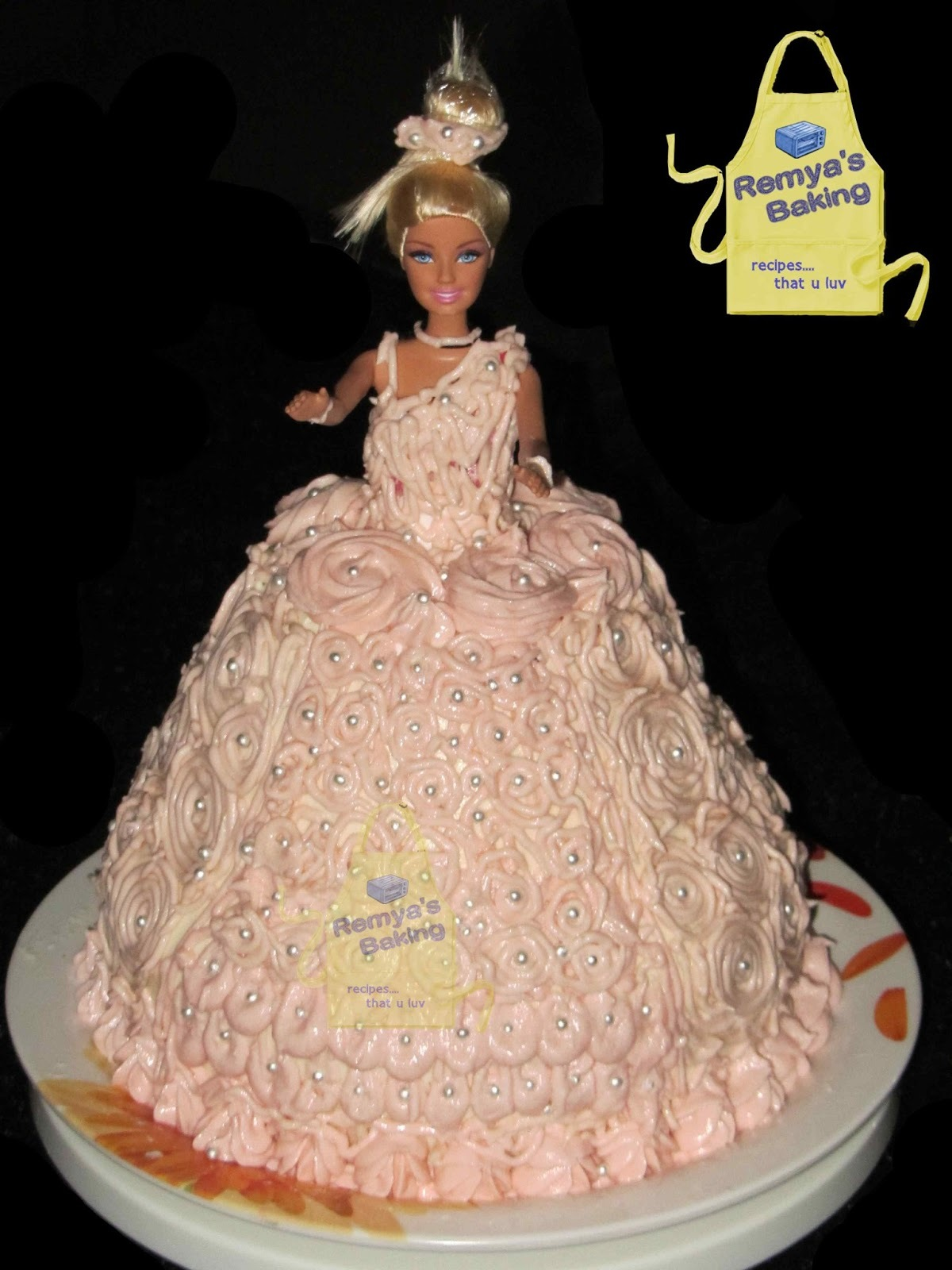 A four layer Barbie doll cake for my little Princess