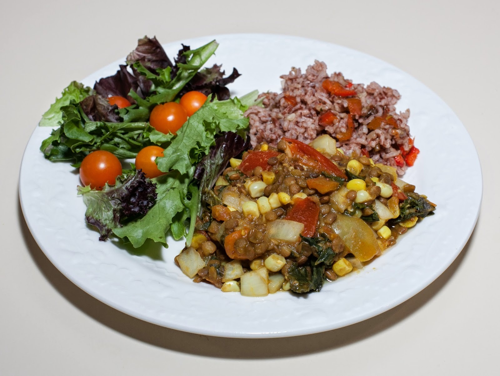Brown Lentil Dhal with Kale, Corn, and Preserved Lemon, served with Madagascar Pink Rice, Baby Lettuces, & Sungold Tomato (No Added Fat)
