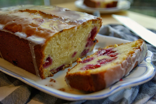 Iced lemon curd and raspberry loaf