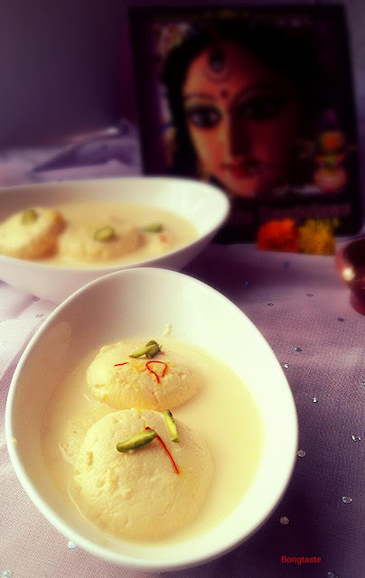 RASMALAI  (INDIAN SWEET SPECIALLY POPULAR IN WEST BENGAL,EASTERN PART OF INDIA )FLAT SHAPED  PANEER OR COTTAGE CHEESE BALL SOAKED INTO CREAMY, SAFFRON FLAVORED MILK.