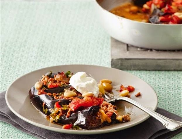 Stuffed aubergines casserole with mildly spiced ground meat and almonds