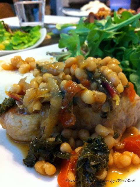 Braised Pork Chops with Smoked Beef Sausage, White Beans, Beet Greens and Kale with a Wine Dijon Reduction