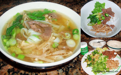 Beef noodle soup with baby bokchoy and enoki mushrooms