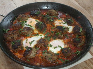 Kefta Mkaouara, or a simple, tasty Moroccan dish of lamb meatballs and egg in a tomato and cumin sauce.