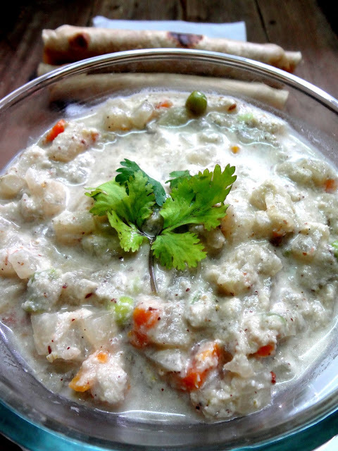 Mixed vegetables cooked in a thick coconut creamy sauce with Indian spices  ( Veg Korma...Restaurant Style )