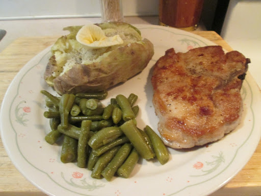 Fried Pork Chop w/ Green Beans, Baked Potato, and Whole Grain Bread