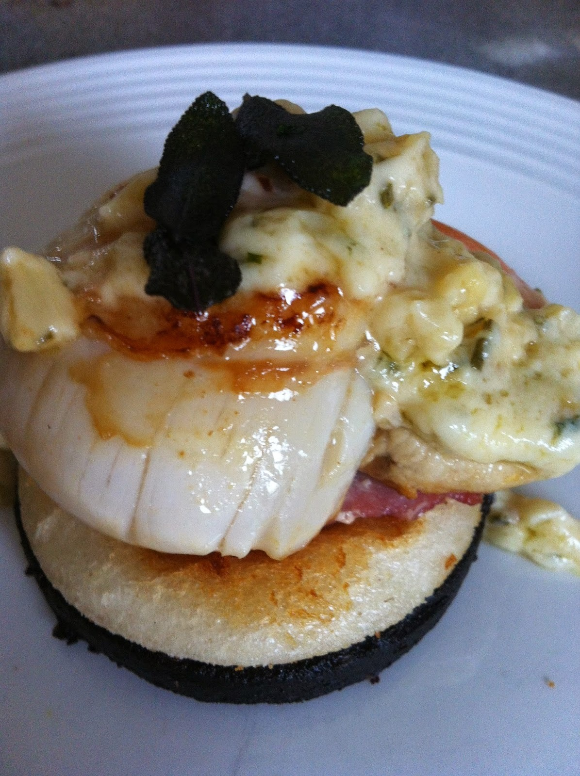 Scallops with black pudding in a creamy garlic and white wine reduction