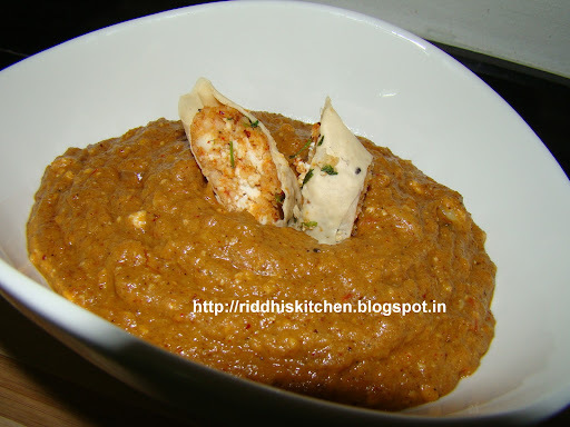 Paneer Patiyala ( paneer and cheese stuffed in papad roll with brown gravy )