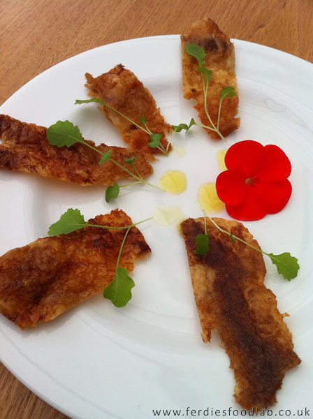 Ski series - Recipe: Crispy Chicken Skins, garnished w/ Nasturtiums and Cress Shoots