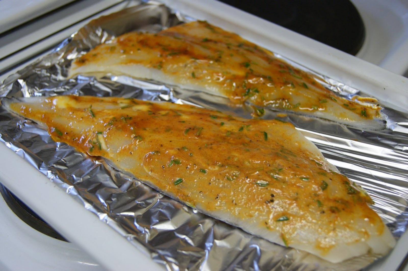 Grilled Haddock with Tomato and Rosemary Butter - Surprisingly Frugal