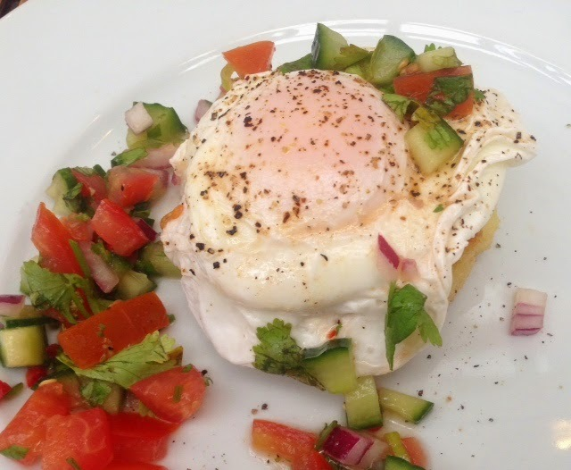 Poached eggs with tomato concasse by Maria Kuehn