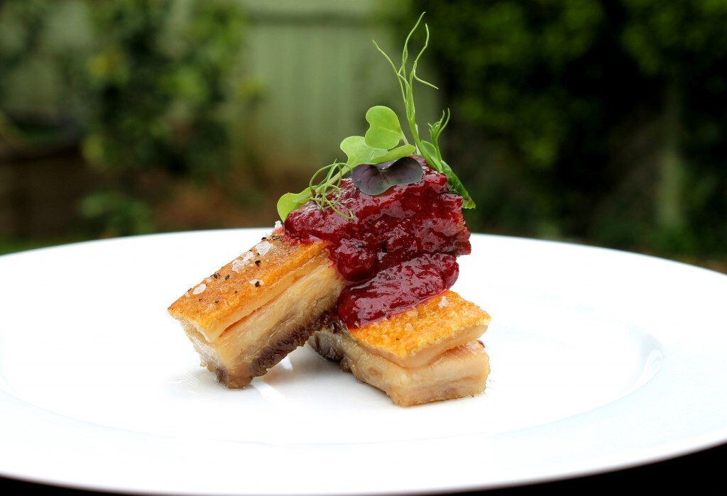 Crispy confit pork belly with spiced Black Doris plum sauce