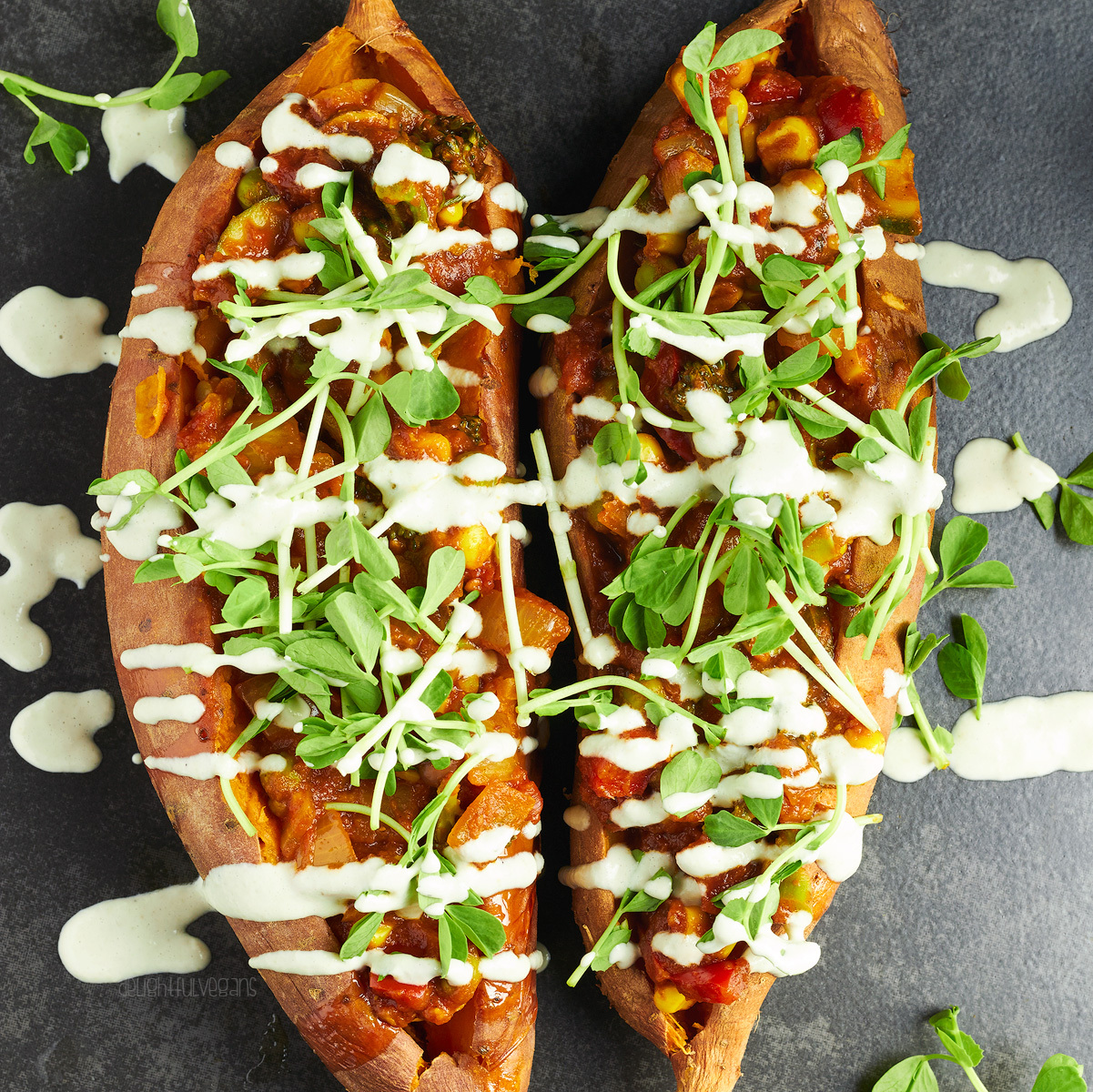 Korma Stuffed Sweet Potatoes with a Garlic Tahini Dressing