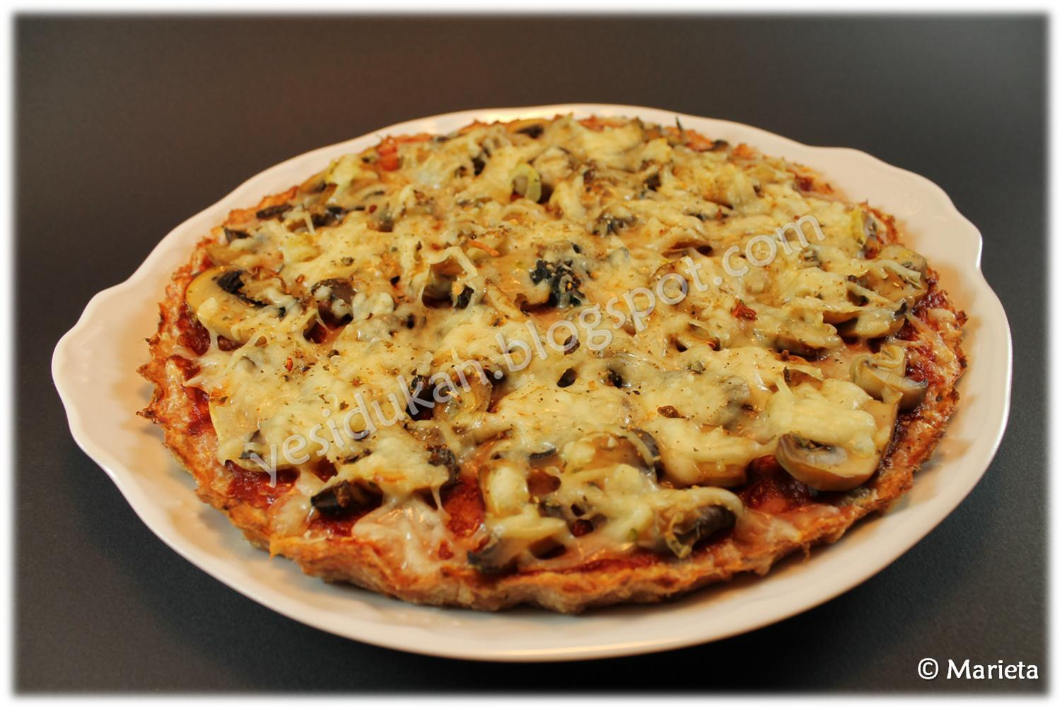Pizza con base de carne