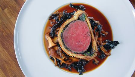 Beef Wellington with wild mushroom Madeira sauce