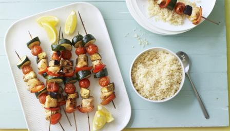 Sticky chicken and vegetable kebabs with couscous