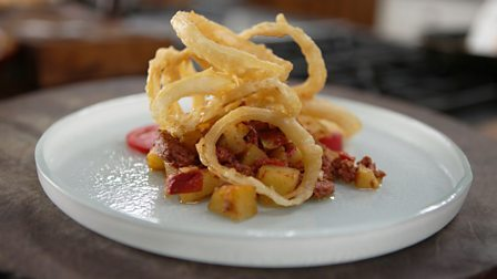 Corned beef hash with beer-battered onion rings