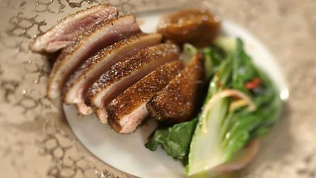 Duck breast with umeboshi sauce and steamed bok choi