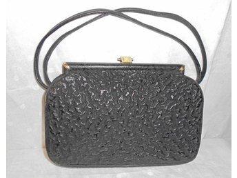 väska av svart läder, vintage 40-tal