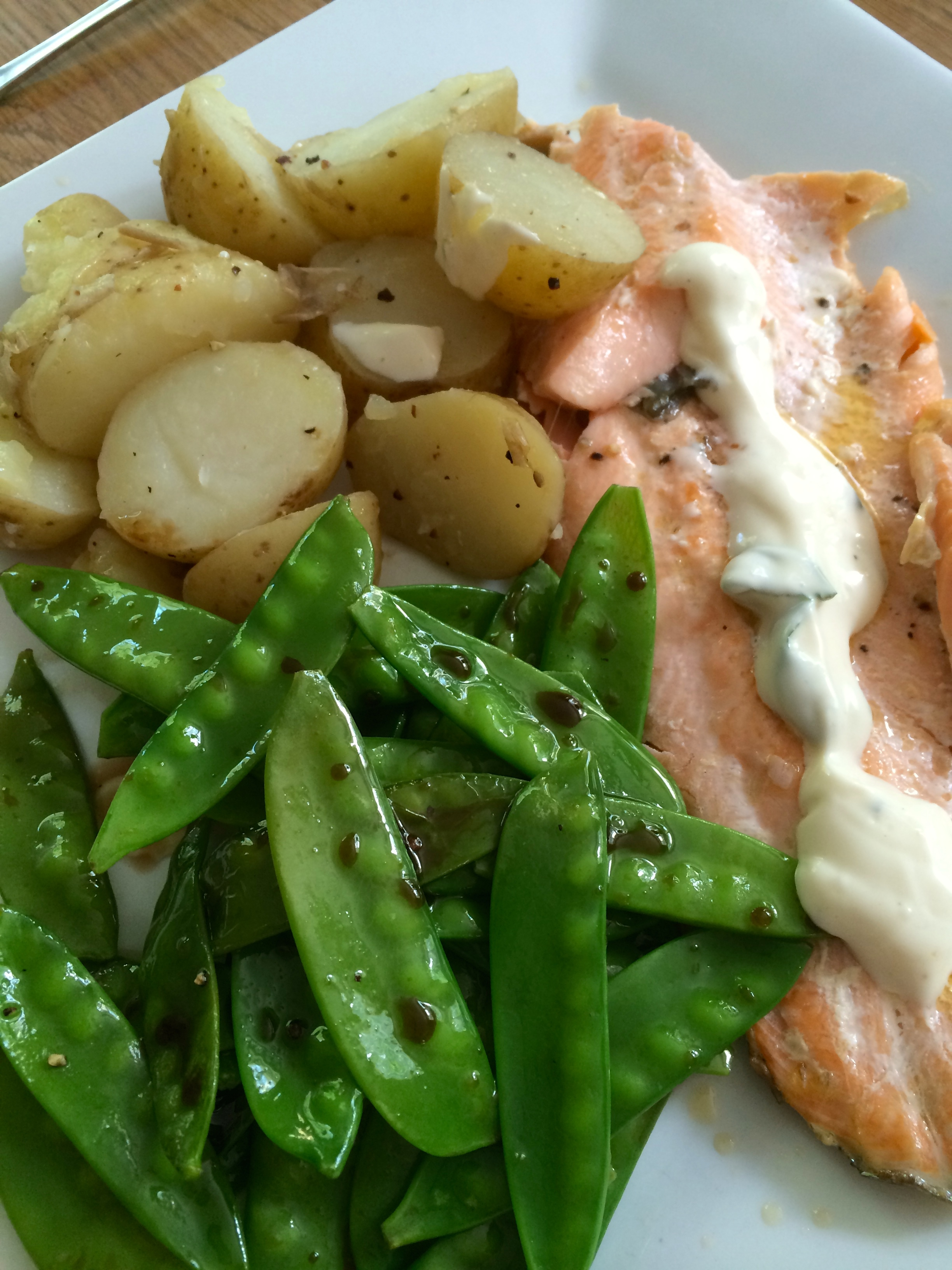 Pan fried trout fillets with a basil and lime mayo, balsamic mange tout and buttered Jersey Royals…