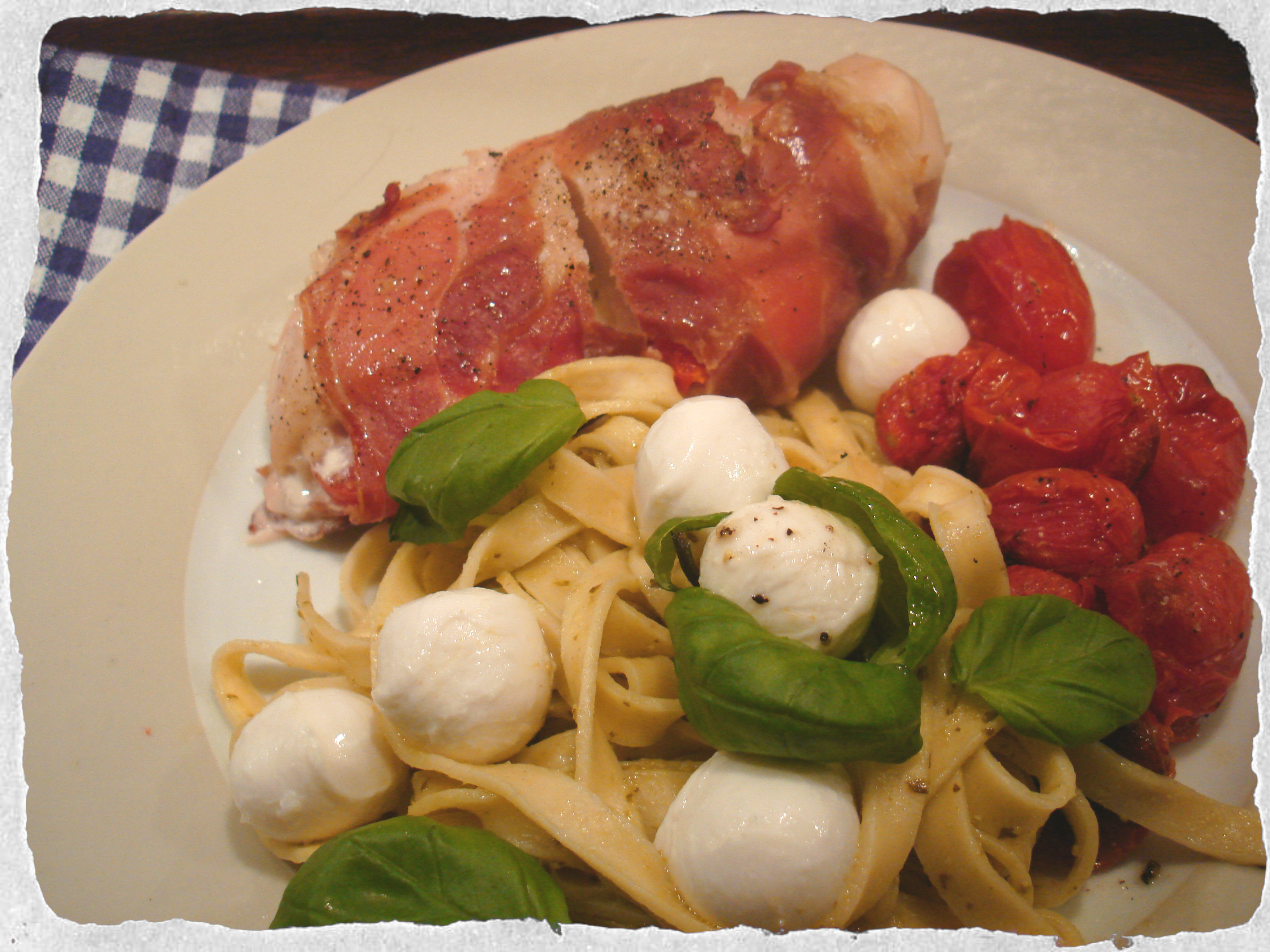 Dinner for one – Stuffed chicken breast, pesto pasta and roasted cherry tomatoes