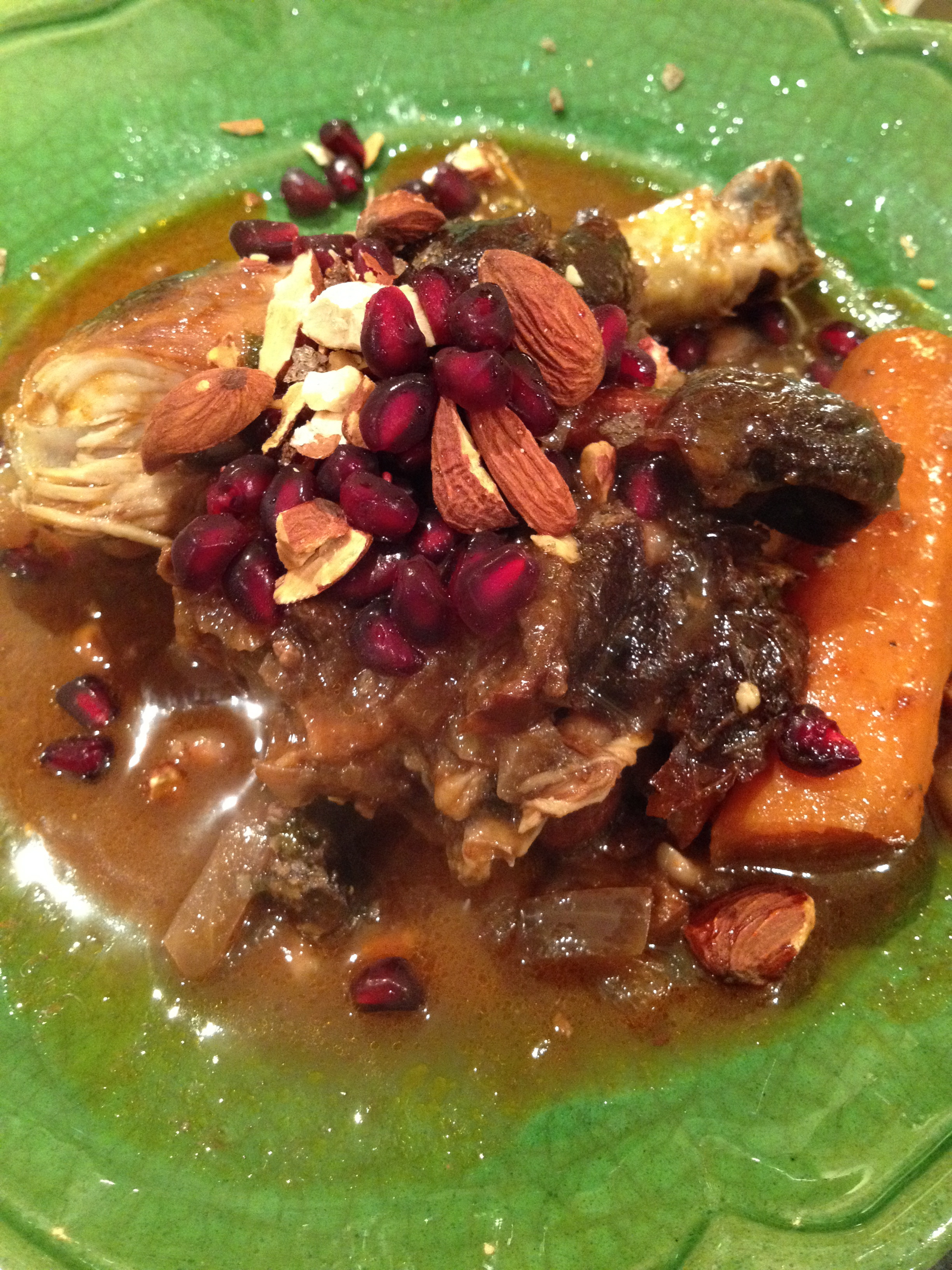 Tagine of chicken with pomegranate and prunes