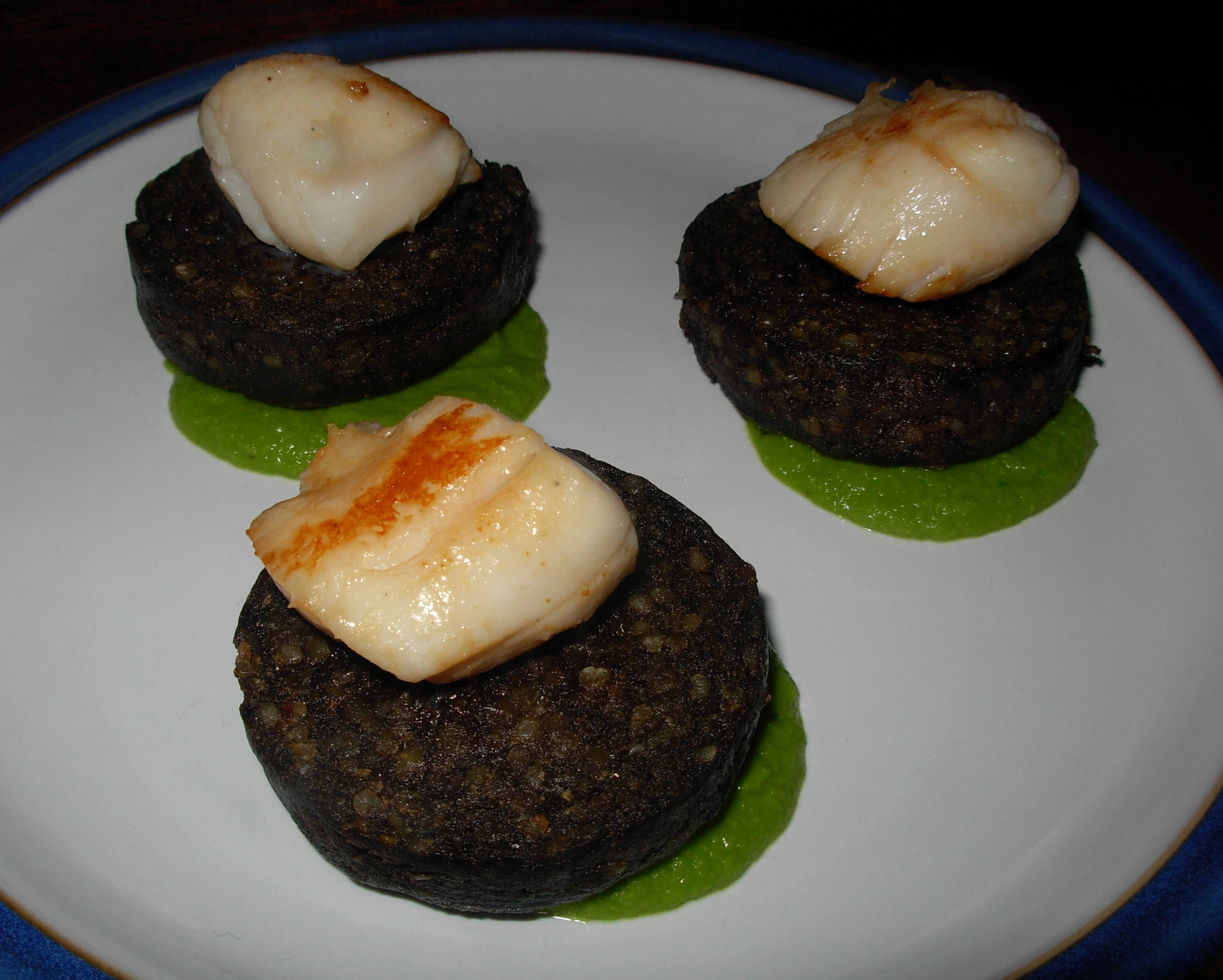 Haggis and scallops on pea purée