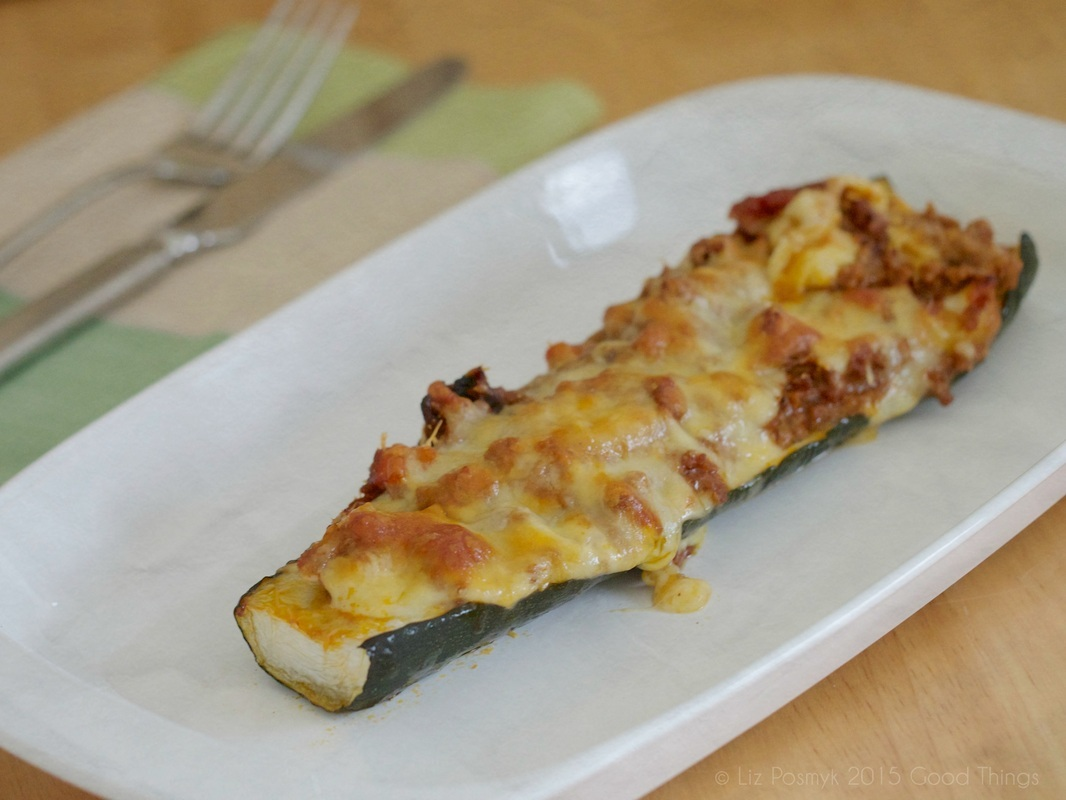 Baked zucchini stuffed with kransky, bacon and bolognaise