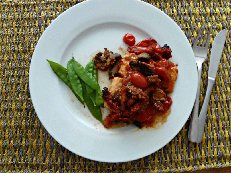 Cod with chorizo and tomato sauce