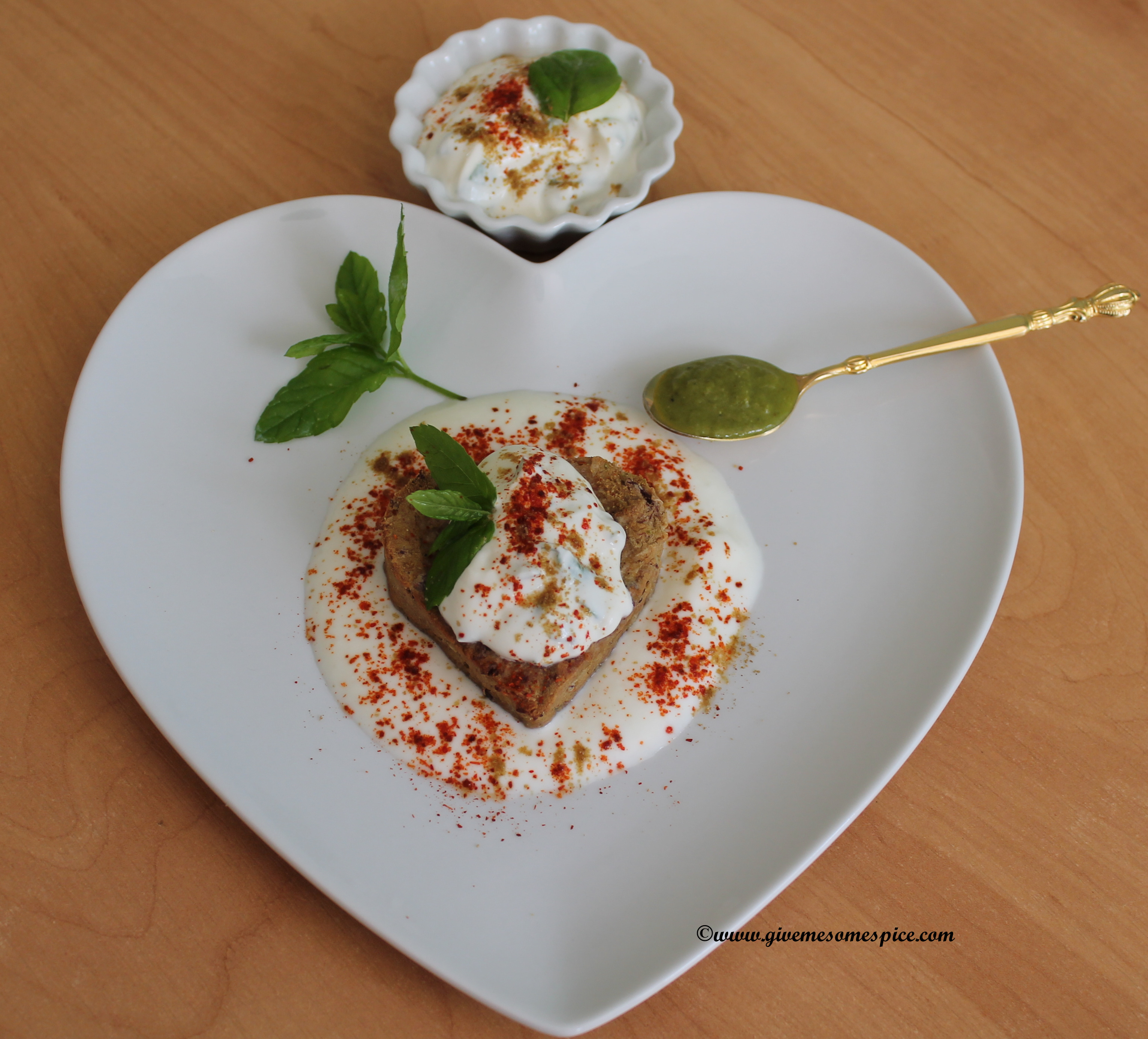 Kidney Bean cutlets dipped in Yogurt and Mint topped with Zhoug
