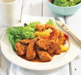 Portuguese chicken tenderloins on warm roasted vegetable salad