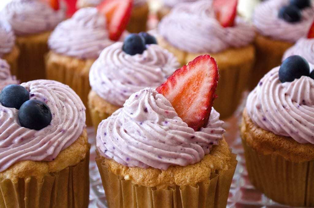 Angel Food Cupcakes with Mixed Berry Whipped Cream Frosting