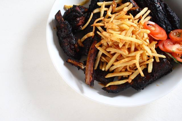 Slow-roasted, char-grilled, very big beef ribs