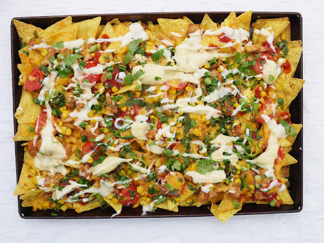 Tandoori Chicken Nachos with Cheddar Sauce.