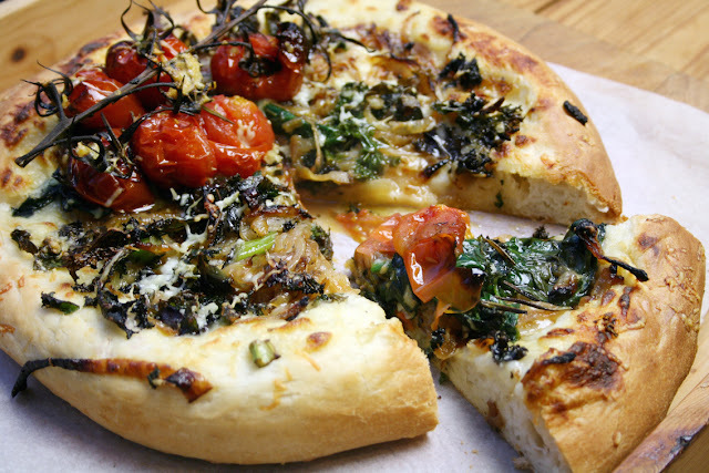 olive oil white sauce pizza with caramelised onions, kale, spinach and tomato