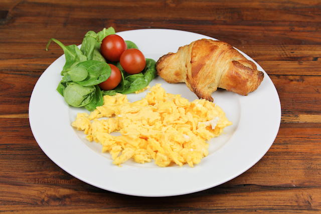 Scrambled eggs and croissant