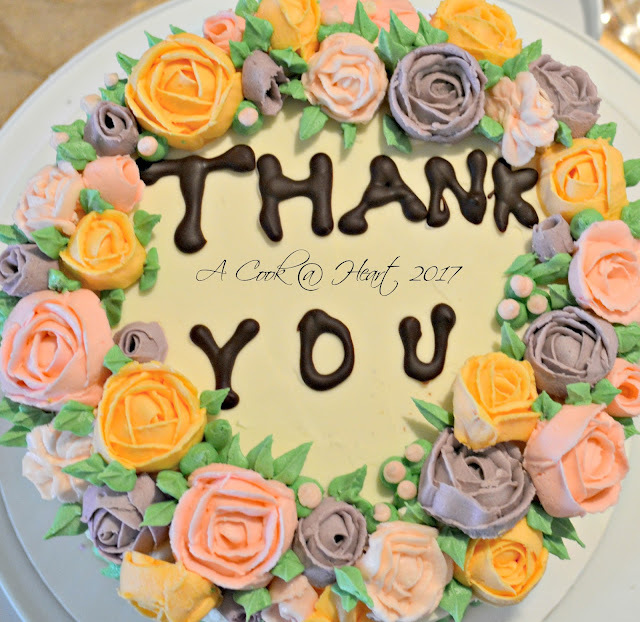 Teacher Appreciation Week and saying Thank You with a chocolate cake with floral decoration.