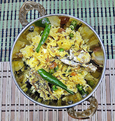 Bengali Murighonto - a pulao like side dish with fish head and rice