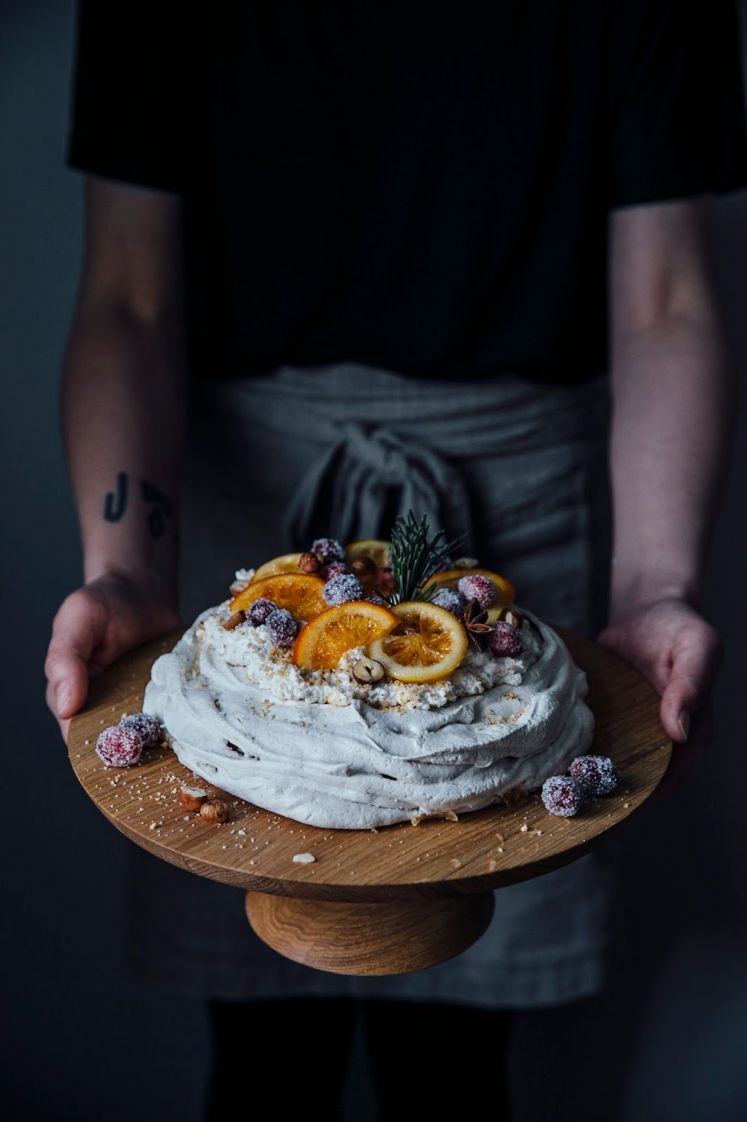 christmas pavlova with sugared cranberries and orange & citron slices