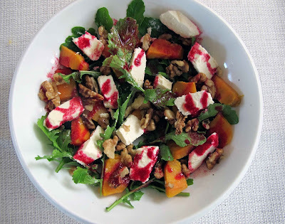 Rocket, kumara, feta and walnut salad with  a ruby red dressing