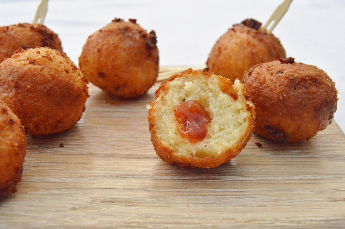 Mini savoury doughnuts with a red pepper chutney filling